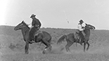 [Unidentified men (2) on horseback]